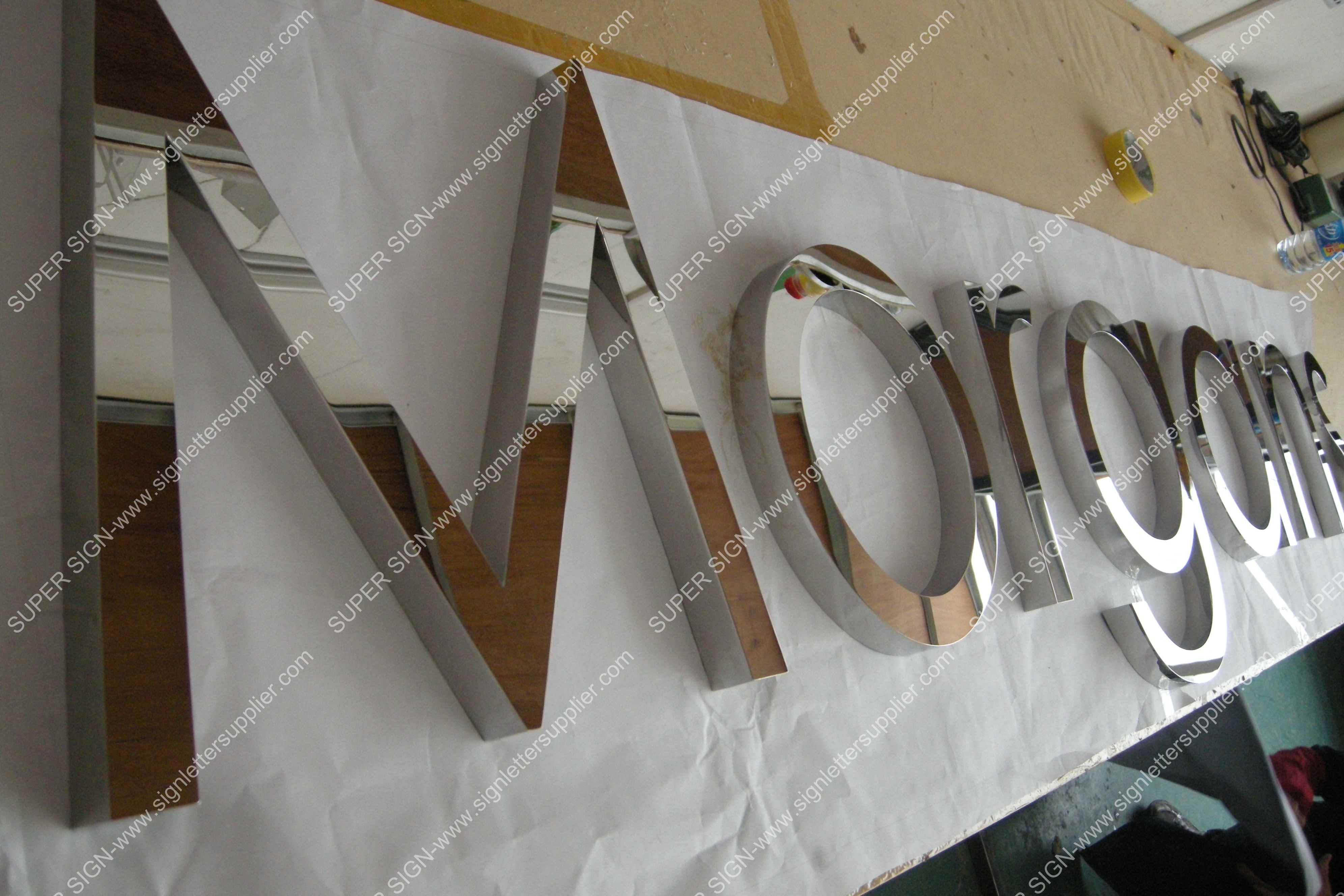 Fabricated polished steel letter